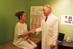Image of chiropractor meeting with young patient